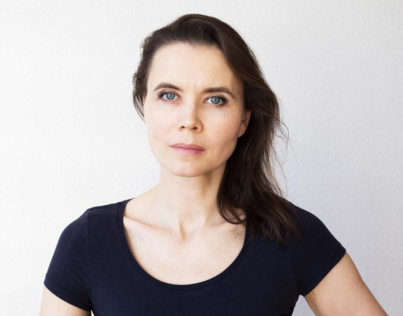 serious woman looking straight at camera