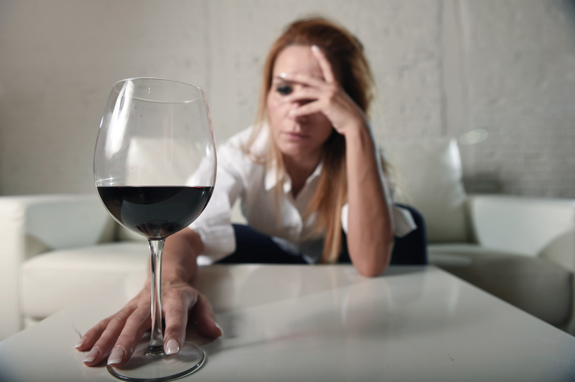 upset woman reaching for wine glass - alcohol
