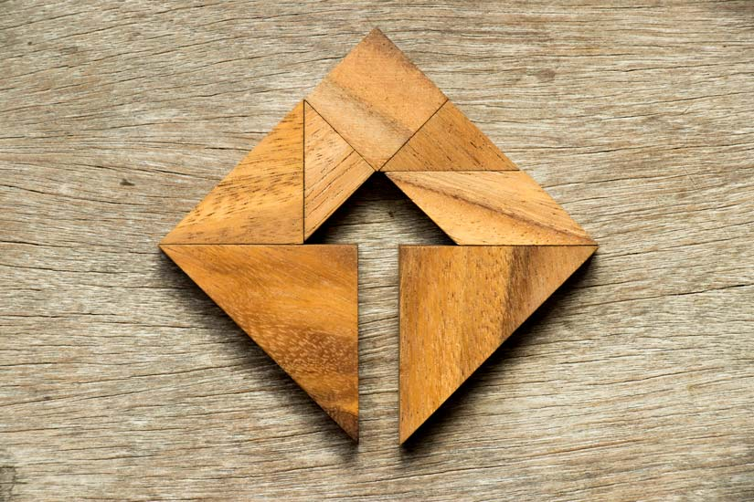 wooden puzzle creating shape of arrow - trauma-responsive