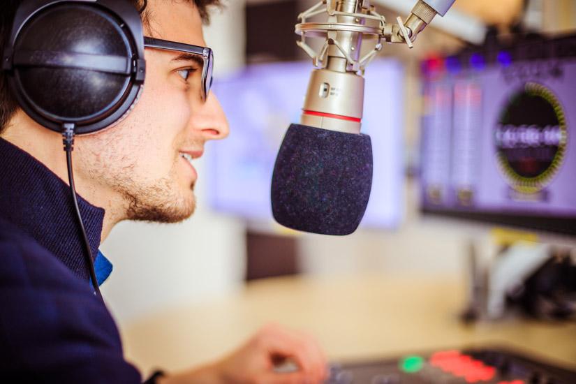 radio talk show host in studio - inner voices